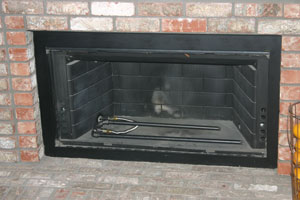 painted fireplace with custom burner