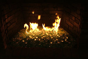 fire rocks in a brick fireplace