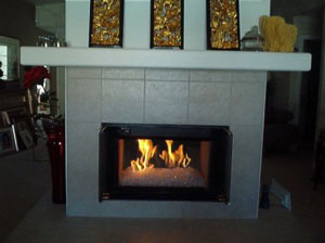 double sided fireplace with fireplace rocks