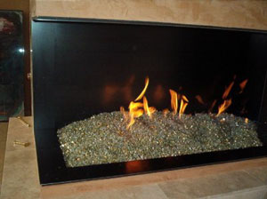 corner fireplace with fire rocks